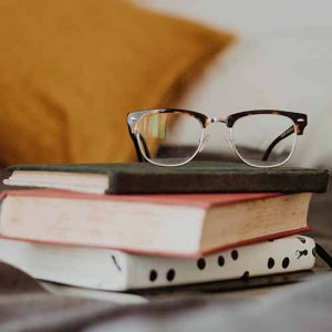 Picture of books with glasses on the top